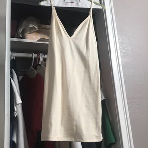 cream body con dress